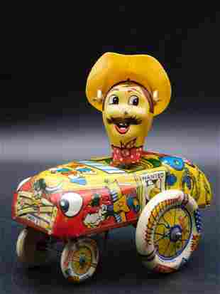 CRAZY COWBOY DRIVER MADE IN GREAT BRITAIN TIN TOY
