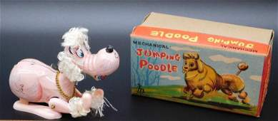 MECHANICAL JUMPING POODLE WITH ORIGINAL BOX TIN TOYS,