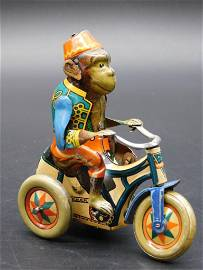 GERMAN MONKEY ON BICYCLE TIN TOY