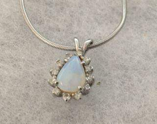 Diamonds in 14kt Gold & Opal Center Necklace is 14kt