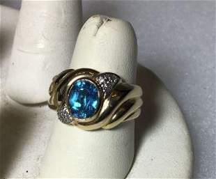 14 KT Gold Ring w/ Blue Topaz size 7, Has Diamond