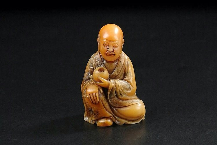 A SHOUSHAN SOAPSTONE FIGURE OF A SEATED LUOHAN