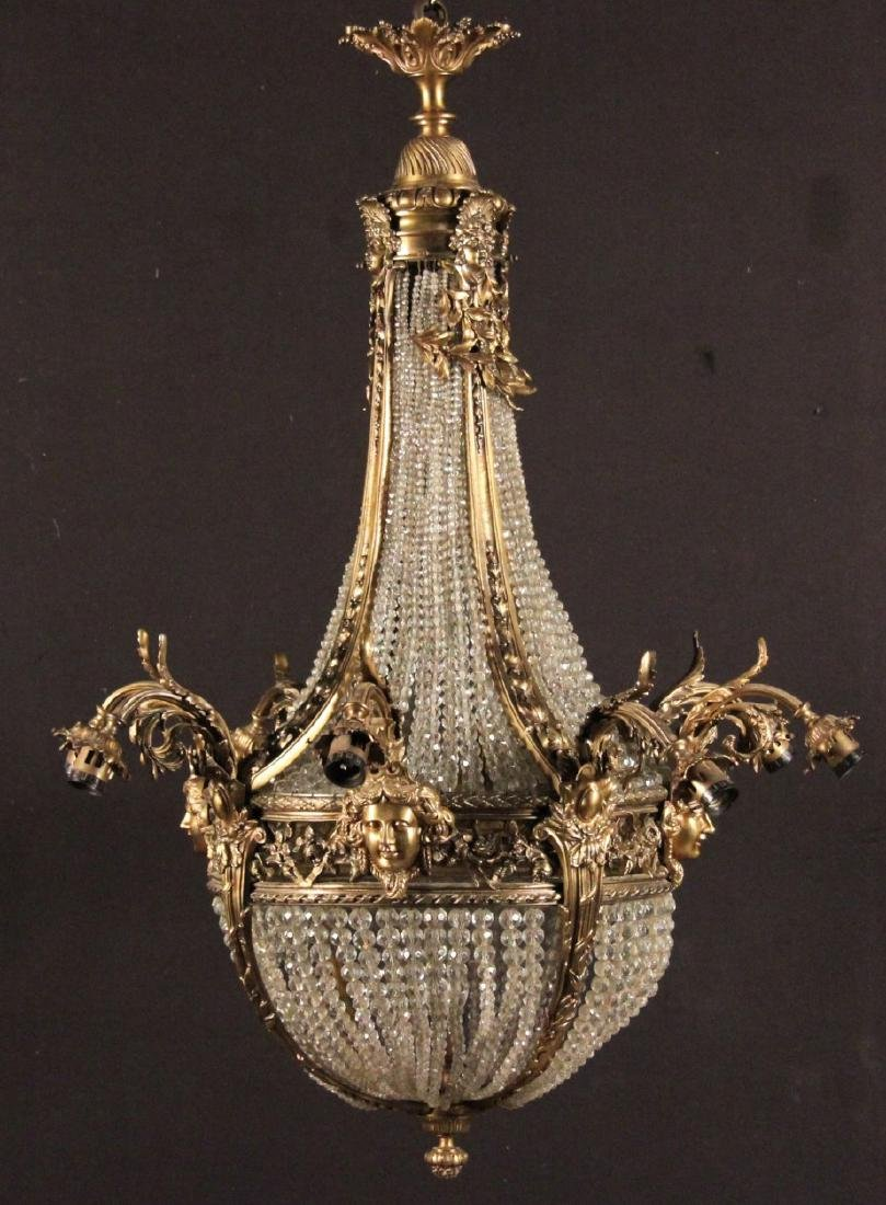 FRENCH 8 LIGHT BRONZE AND CRYSTAL CHANDELIER