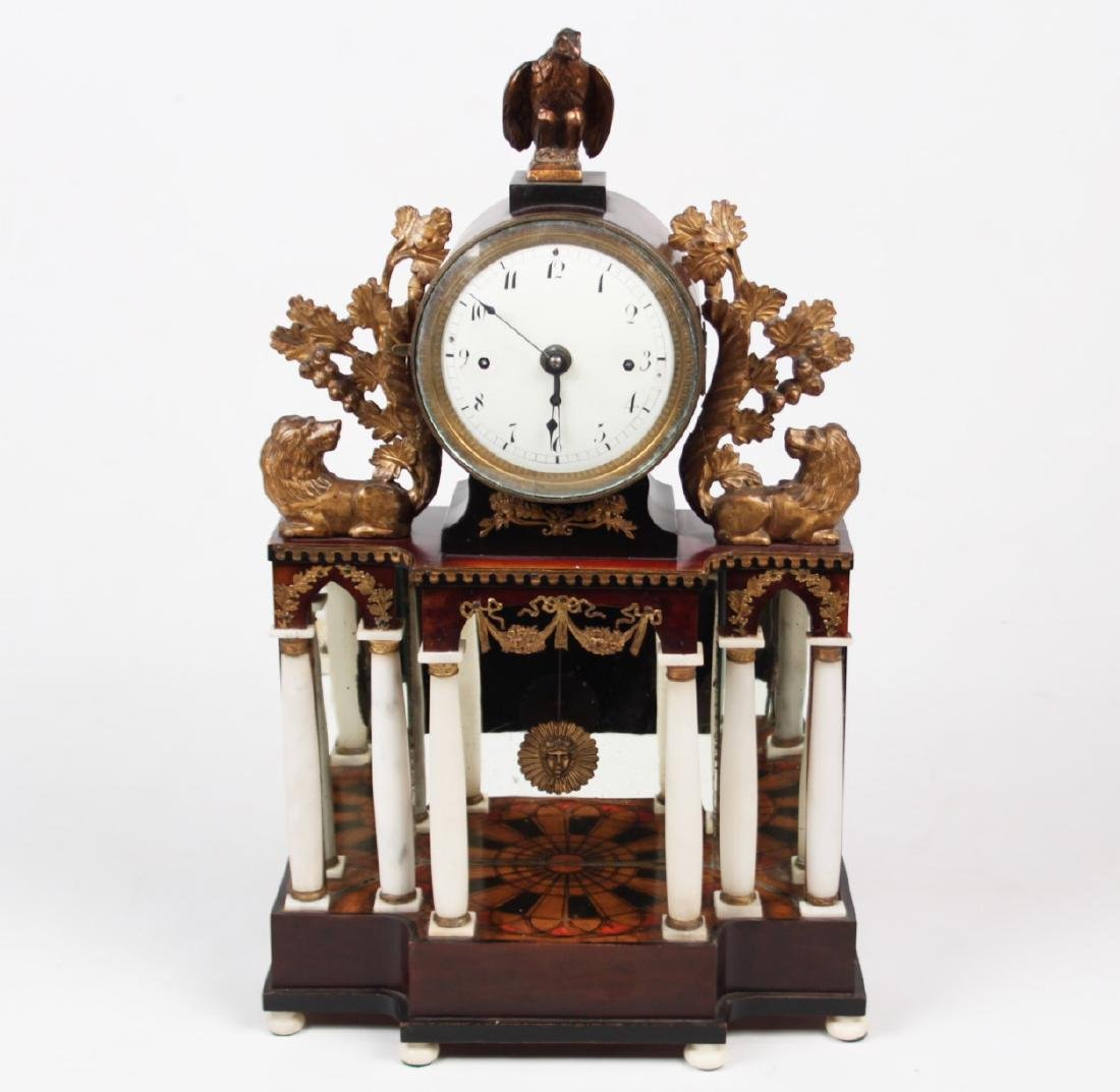 AUSTRIAN GILT METAL AND CARVED WOOD MANTLE CLOCK