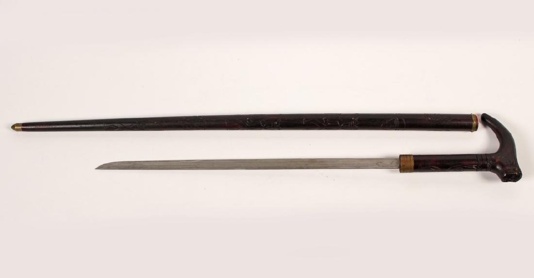 ASIAN MAHOGANY SWORD CANE W/CARVED HANDLE AND SHAFT
