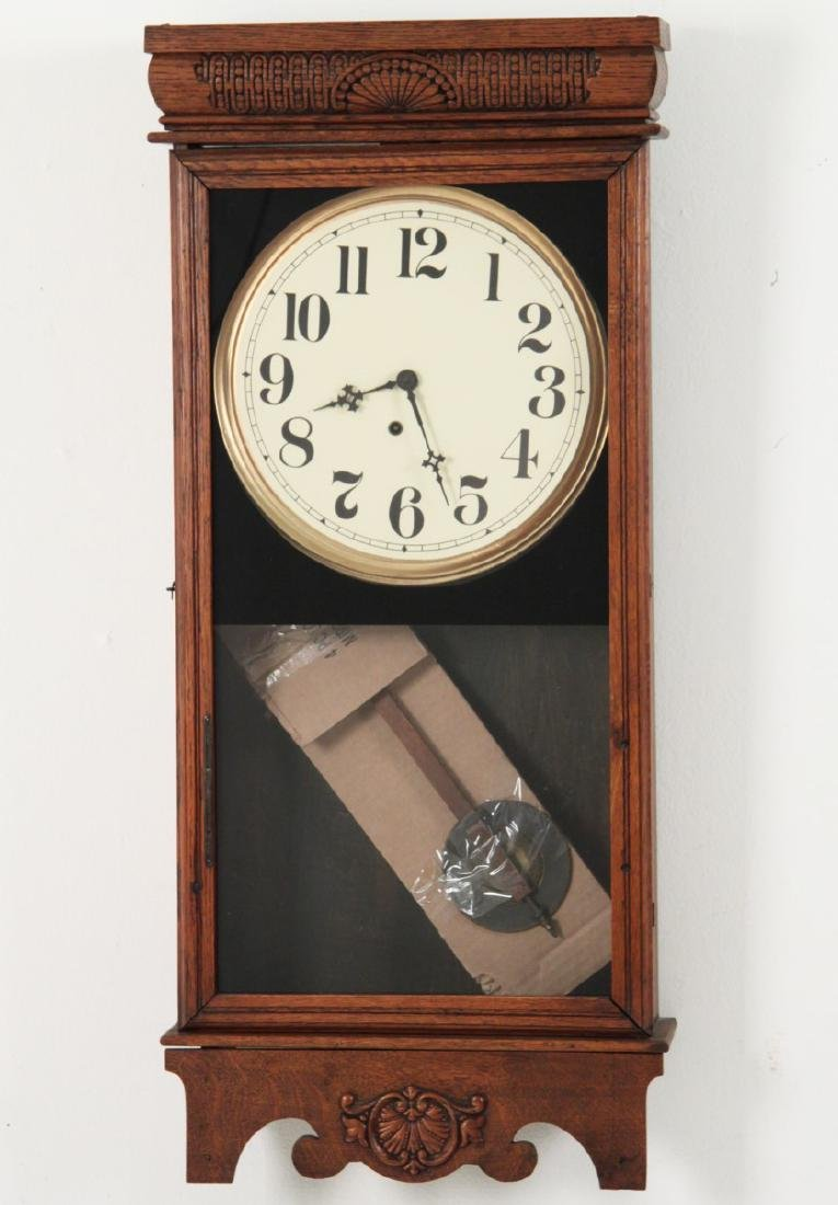 AMERICAN OAK WALL CLOCK WITH PENDULUM