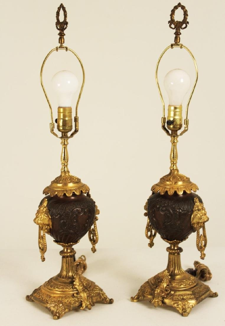 PAIR OF FRENCH BRONZE AND GILT URNS, AS LAMPS
