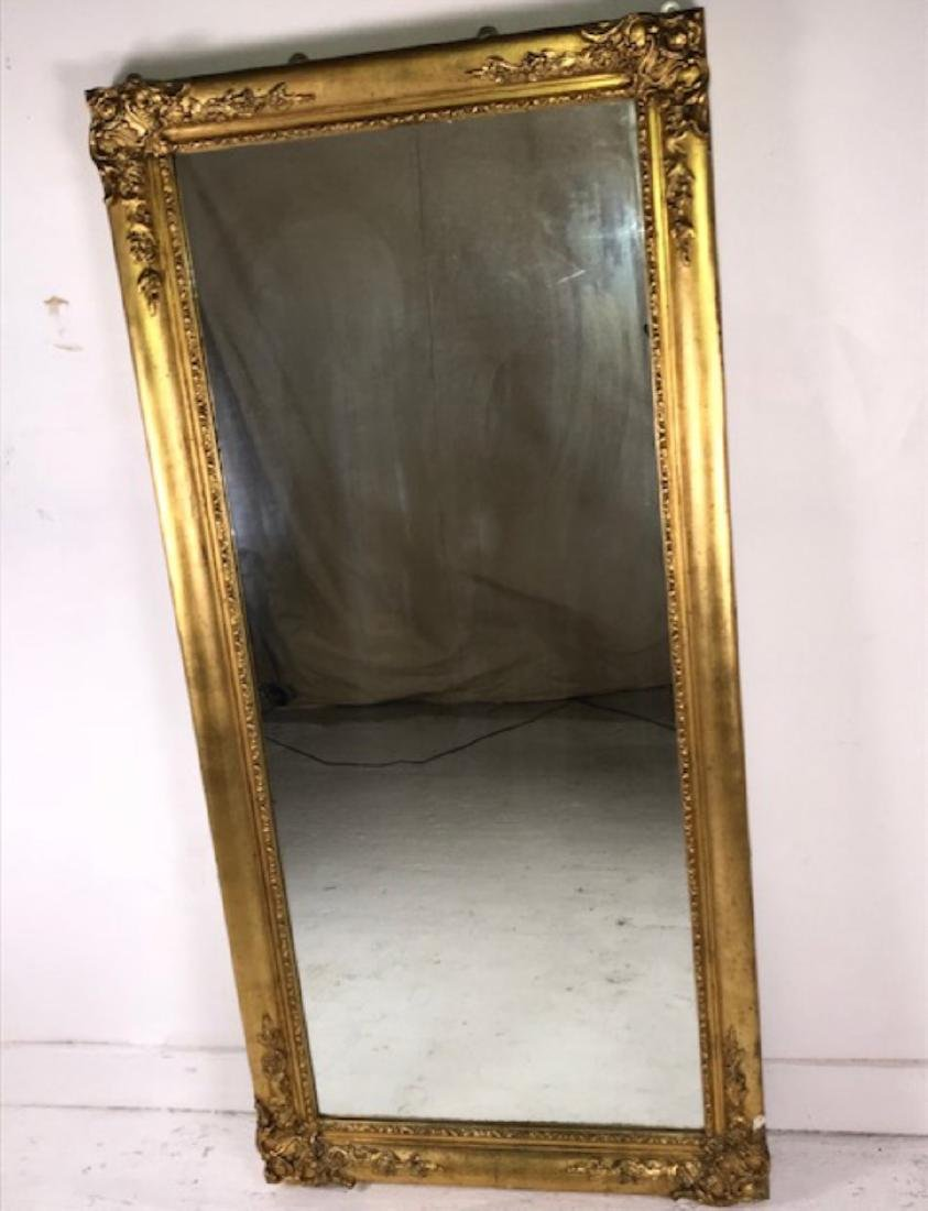 LARGE FRENCH OGEE SHAPED CARVED GILT WOOD MIRROR