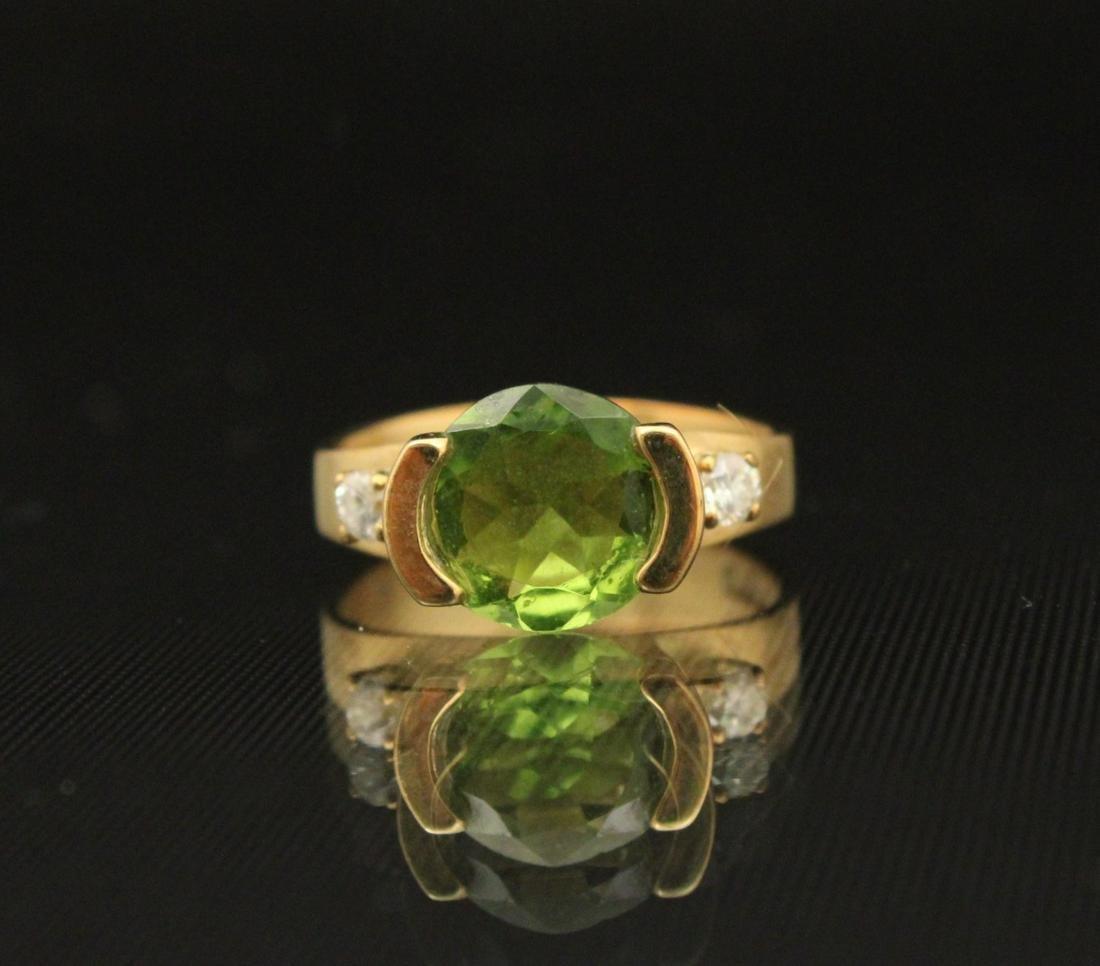 18K Y/G PERIDOT AND DIAMOND RING;  4.9 GR TW