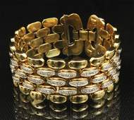 18K Y/G AND DIAMOND FLEXIBLE BRACELET;  83.8 GR TW