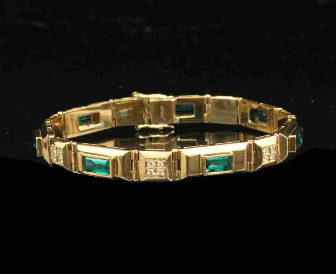 18K Y/G EMERALD AND DIAMOND BRACELET;  33.8 GR TW