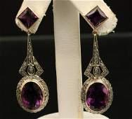 Pr of 18k Diamond and amethyst earrings