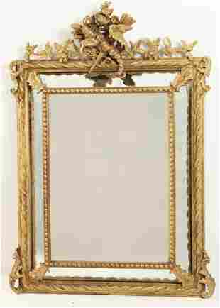 CARVED GILTWOOD FRENCH CUSHION LOOKING GLASS