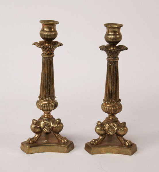 PAIR OF FRENCH REGENCY POLISHED BRONZE CANDLESTICKS