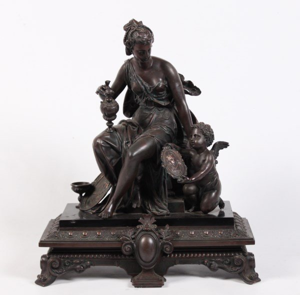 PATINATED METAL AND MARBLE SCULPTURE OF A SEATED FEMALE