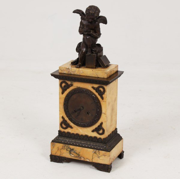 19TH C. BRONZE AND JAUNE MARBLE FRENCH CLOCK WITH PUTTI