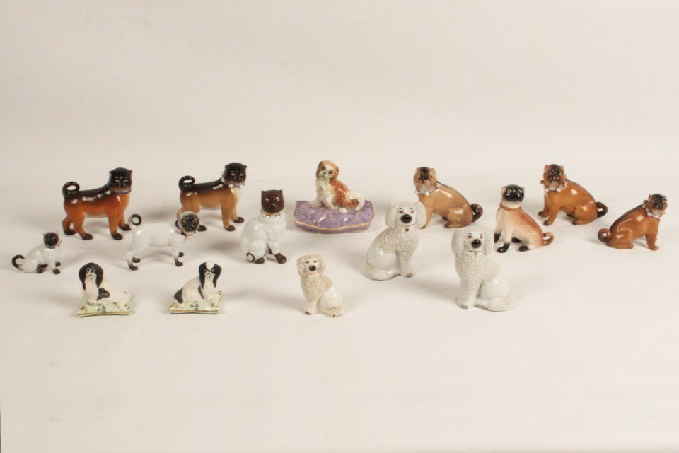 GROUP OF 15 PORCELAIN AND STAFFORDSHIRE FIGURES OF DOGS