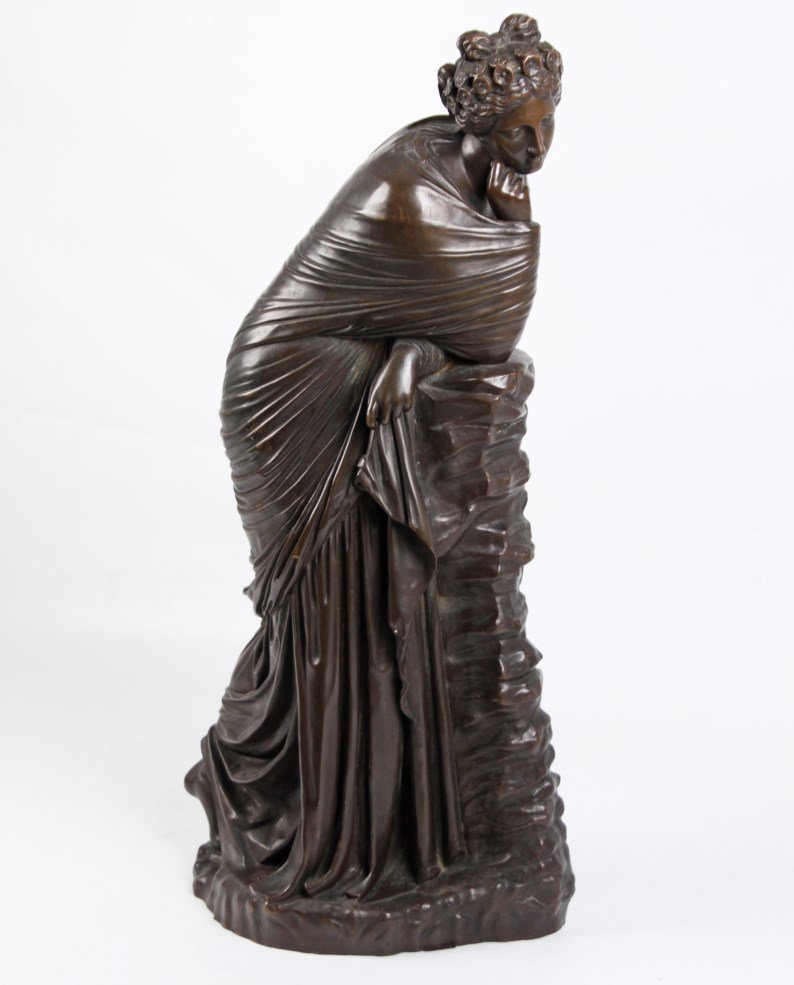 FRENCH BRONZE SCULPTURE OF WOMAN RESTING ON WALL