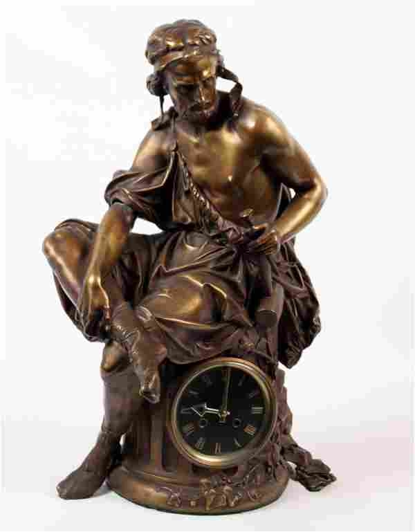 CARRIER, SIGNED BRONZE SCULPTURE ON CLOCK FORMED
