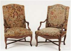 PAIR OF LOUIS XV CARVED WALNUT FAUTEUILS