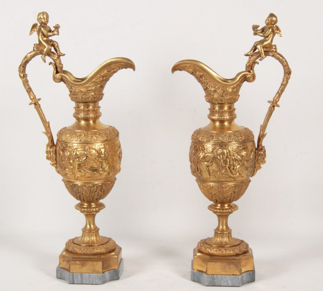 PAIR OF FRENCH DORE BRONZE PUTTI MOUNTED EWERS