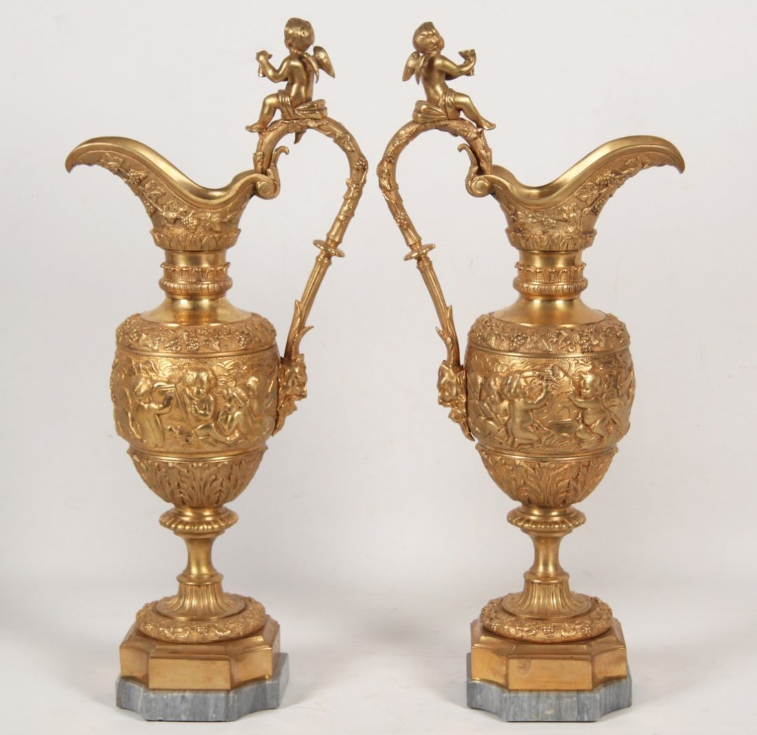 PAIR OF FRENCH DORE BRONZE PUTTI MOUNTED EWERS - 2