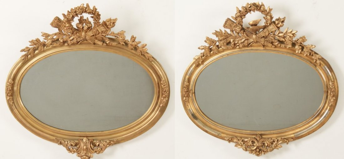PAIR OF LOUIS XV STYLE CARVED GILTWOOD OVAL MIRRORS