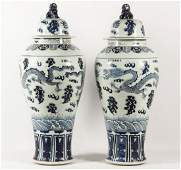 PAIR OF LARGE BLUE AND WHITE CHINESE PORCELAIN CAPPED