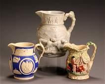 1469: Group of Three English Molded Ceramic Pitchers