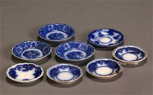 Group of Eight Flow Blue Butter Pats