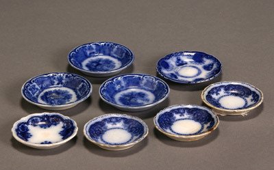 18: Group of Eight Flow Blue Butter Pats