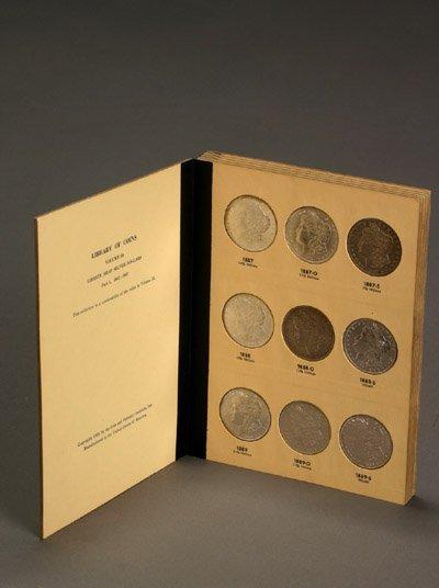 1020: One Album of U.S. Morgan Silver Dollars, 1897-192