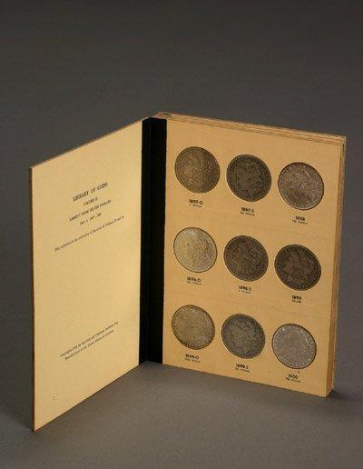 1021: One Volume of U.S. Morgan Silver Dollars
