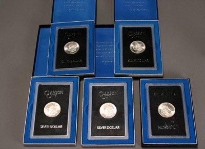 1023: Five U.S. Carson City Silver Dollars