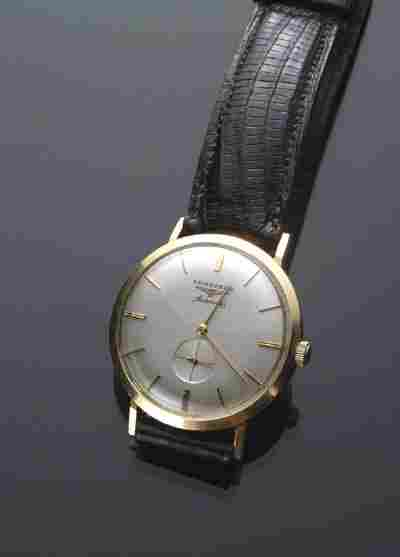 1033: Gentleman's 14 Karat Yellow Gold Automatic Wrist
