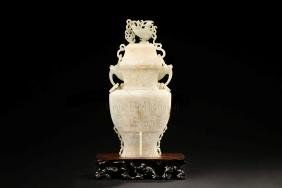 JADE CARVED VASE WITH COVER AND LOOPED HANDLES