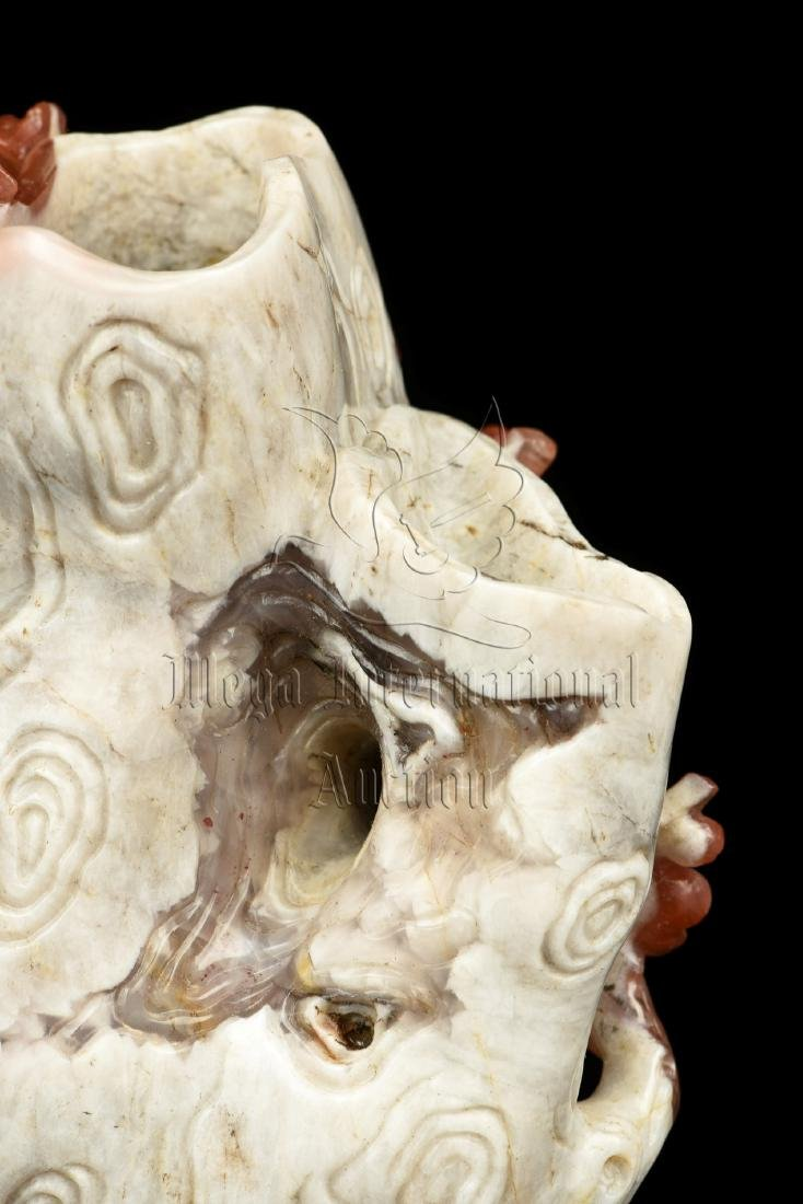 CLEVERLY CARVED NANHONG AGATE 'FLOWERS' FIGURE - 8