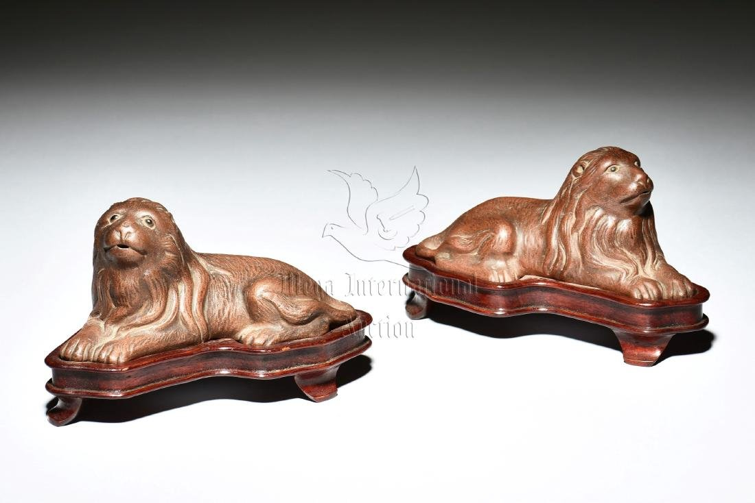 PAIR OF YIXING ZISHA DOG FIGURES WITH STANDS