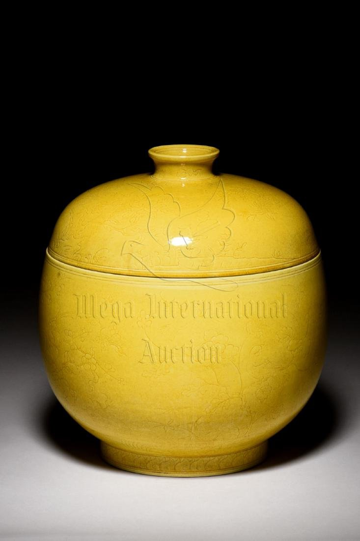YELLOW GLAZED AND CARVED 'FLOWERS' JAR WITH COVER