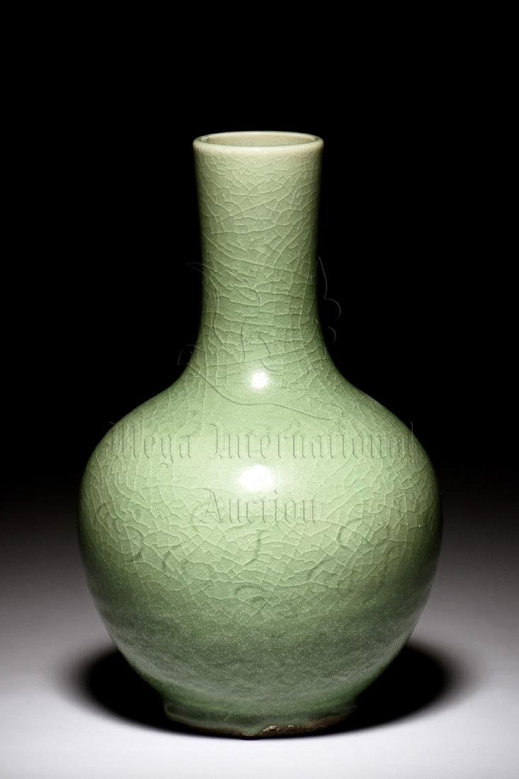 CELADON GLAZED AND IMPRESSED VASE