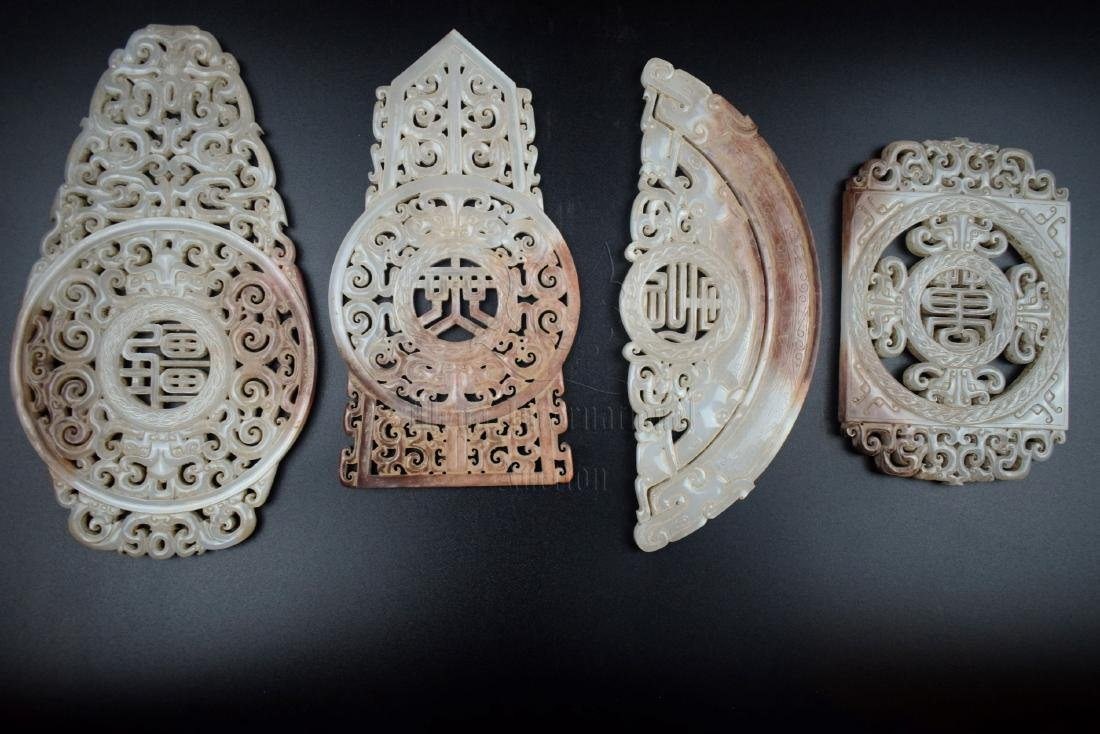FOUR JADE OPENWORK CARVED 'MYTHICAL BEASTS' DISCS