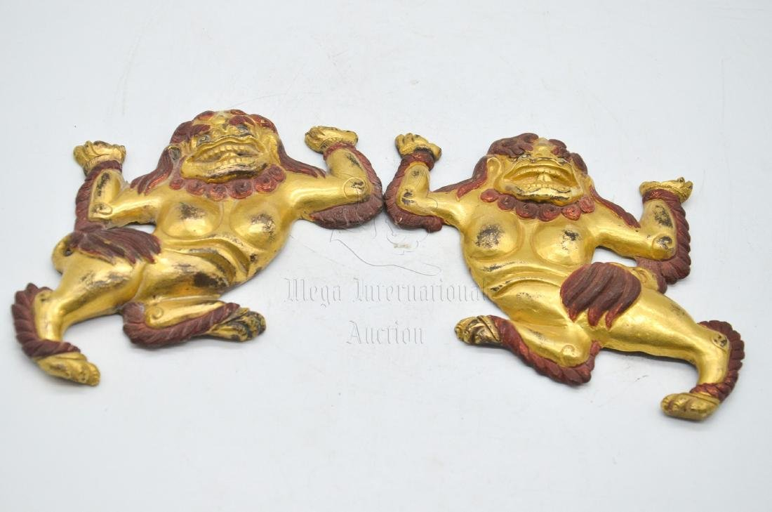 PAIR OF GILT BRONZE 'MYTHICAL LIONS' WALL PLAQUE
