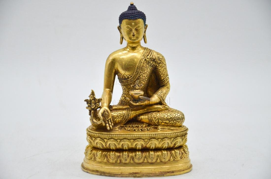 GILT BRONZE CAST BHAISAJYAGURU SEATED FIGURE