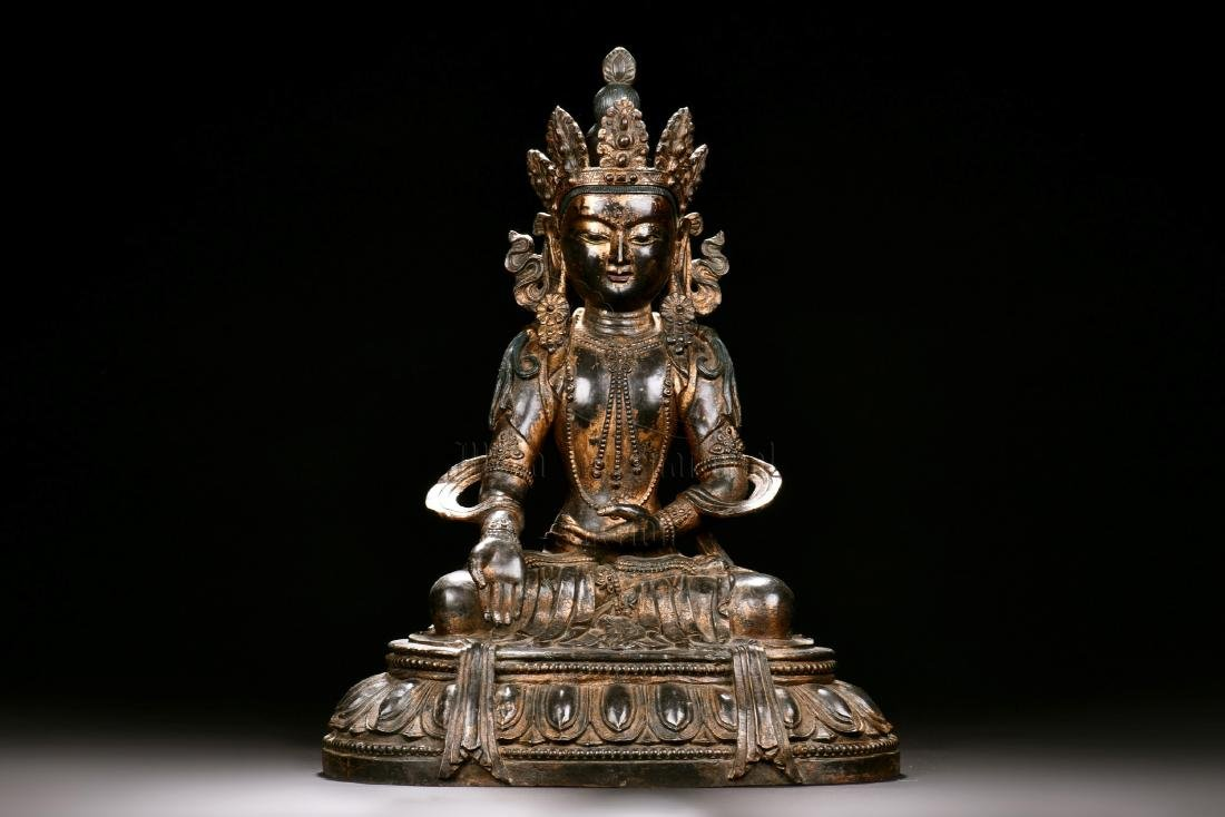 RED COPPER AND SPLASH GILT SEATED GUANYIN FIGURE