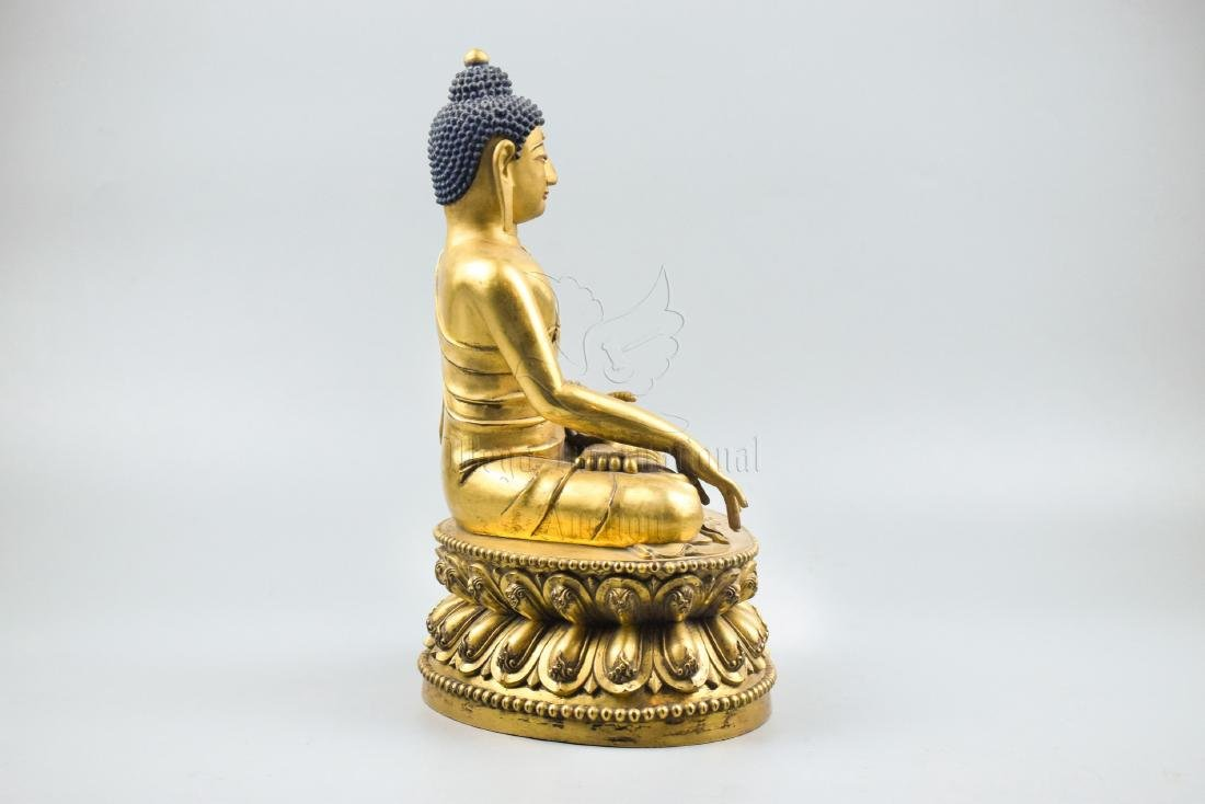 GILT BRONZE CAST SHAKYAMUNI SEATED FIGURE - 2