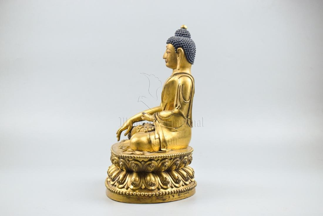 GILT BRONZE CAST SHAKYAMUNI SEATED FIGURE - 3