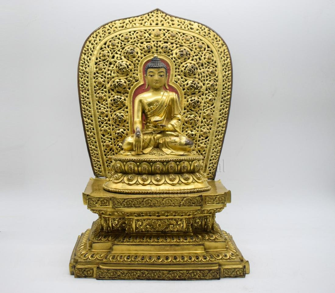 GILT BRONZE CAST 'SHAKYAMUNI' SEATED FIGURE
