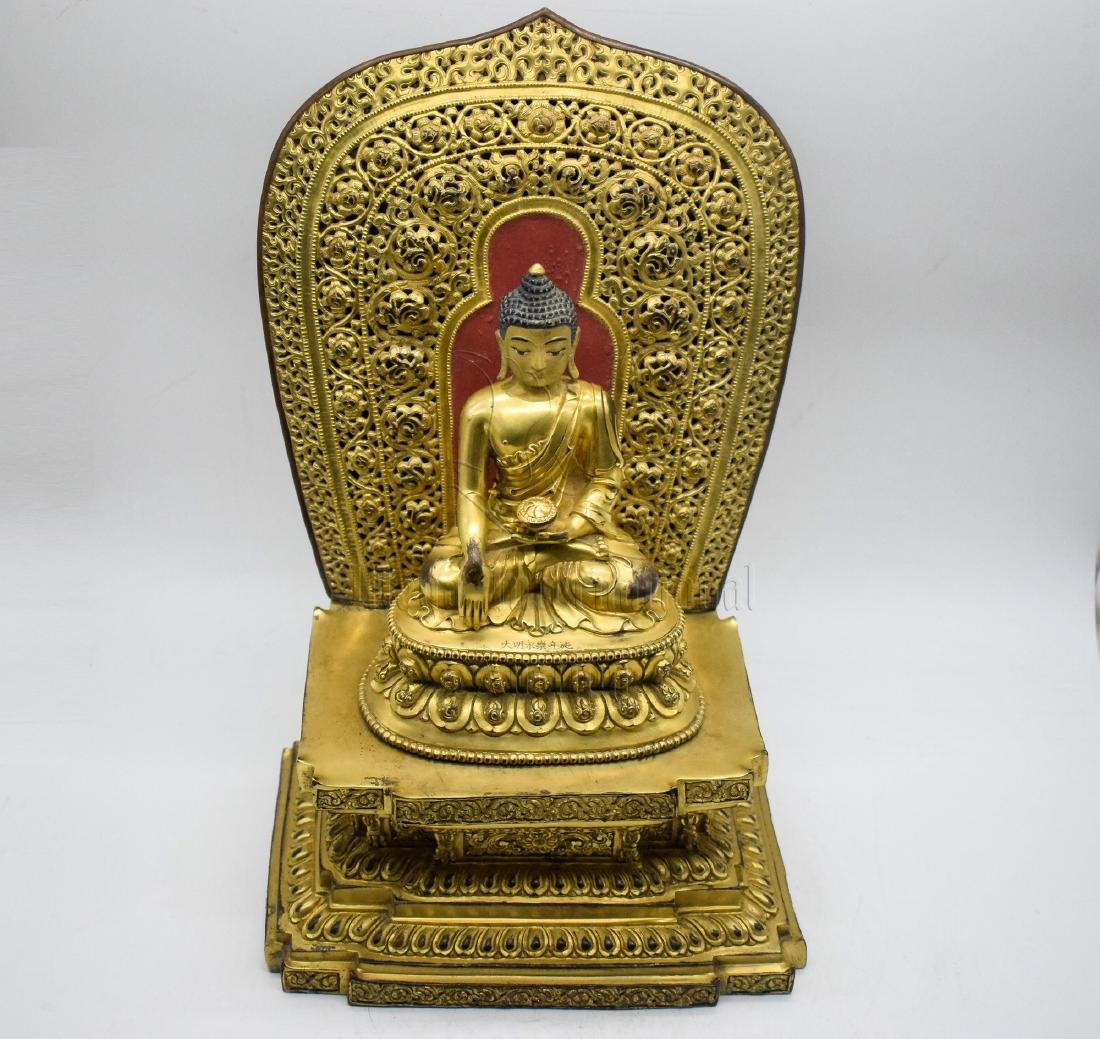 GILT BRONZE CAST 'SHAKYAMUNI' SEATED FIGURE - 2