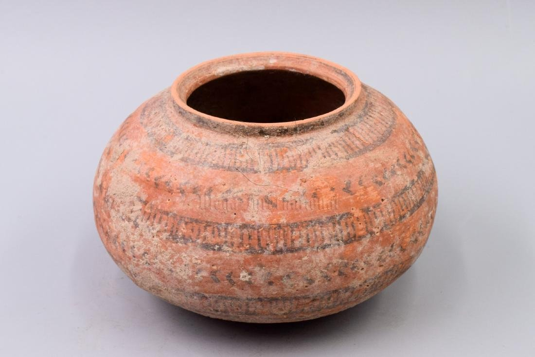 POTTERY JAR WITH PAINTED EXTERIOR