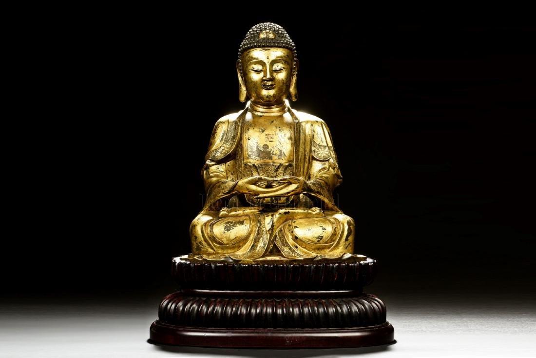 GILT BRONZE CAST SHAKYAMUNI BUDDHA SEATED FIGURE